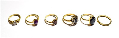 Lot 95 - A sapphire and diamond cluster ring, stamped '18CT', finger size M1/2, an 18 carat gold diamond...