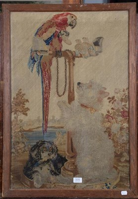 Lot 1016 - An 18th century woolwork picture of a parrot seated on a stand, with two dogs, oak framed, 78cm...