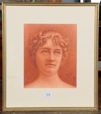 Lot 1018 - A pastel portrait of a young lady, monogrammed M P 1897, 29cm by 24cm