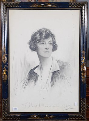Lot 1089 - Charcoal portrait of a lady, indistinctly signed and dated 1927, in a blue lacquered chinoisere...