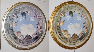 Lot 1093 - A pair of circular ceiling mounted panels, modern in the Renaissance style, with moulded silver and