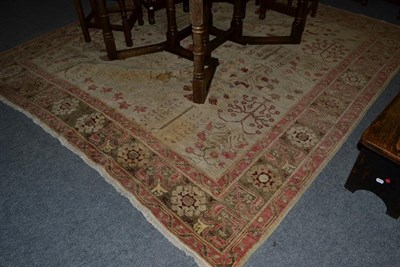Lot 1097 - An Ushak Design Carpet, probably Afghanistan, the cream field with a oneway design of plants in...