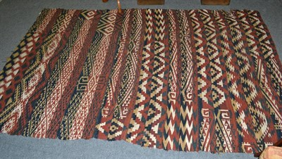 Lot 1098 - A 19th century Shahsavan Kilim, the field of narrow and broad bands of polychrome motifs...