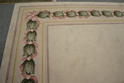 Lot 1099 - A large cream ground carpet with floral border, by Signature Carpets, Hebden Bridge, 6.3m by 4.76m