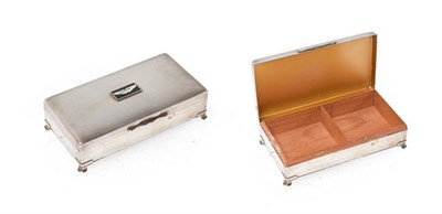 Lot 10 - A Silver Plated Desktop Cigarette Box, the lid with engine turned decoration and an Aston...