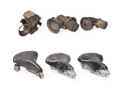 Lot 28 - ~ Three Early 20th Century Carbide Bicycle Lamps; and Three Vintage Leather Motorcycle Seats,...