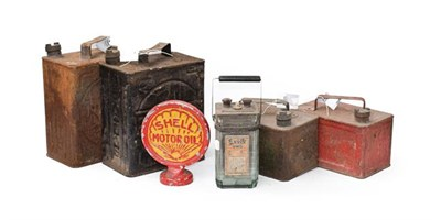Lot 29 - ~ Two Pratts Metal Fuel Cans, 28cm high; A Smaller Red Painted Pratts Fuel Can; A Green Painted...