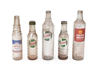 Lot 32 - ~ Five Vintage Glass Oil Bottles, comprising a large Castrol Motor Oil, a Shell X-100, a...