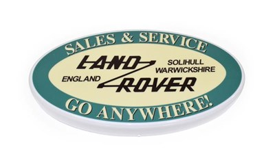 Lot 35 - An Illuminated Car Display Sign: Land Rover Sales and Service Go Anywhere!, with low voltage...