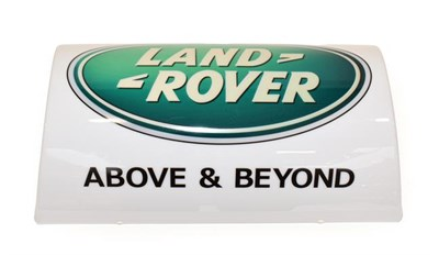 Lot 70 - An Illuminated Car Display Sign: Land-Rover Above and Beyond, with low voltage transformer, 49cm by