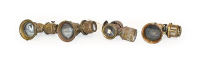 Lot 72 - Four Early 20th Century Brass Bicycle Lamps, comprising one stamped Badger Brass MFG Company...