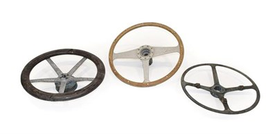 Lot 73 - Three Vintage Steering Wheels, comprising a three-spoke example with moulded wheel, a...