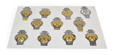 Lot 79 - Eleven Chromed AA Car Badges, including nine World examples, namely Singapore, East Africa, New...