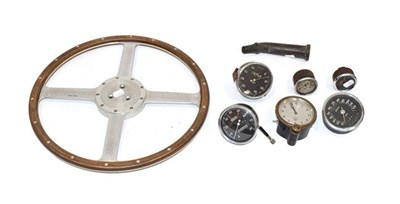 Lot 98 - A Moto-Lita Four-Spoke Riveted Metal Steering Wheel, six assorted car dials, and a solid brass...