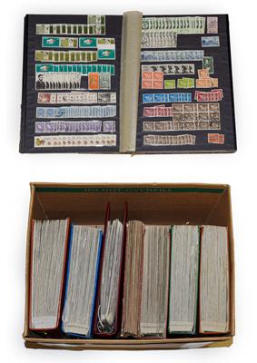 Lot 2029 - Carton containing 7 volumes incl. 5 large Lighthouse stockbooks  with 10s of 1000s of stamps mainly