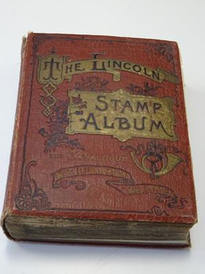 Lot 2040 - Vintage Lincoln album, housing worldwide collection of several hundred different stamps, mint...