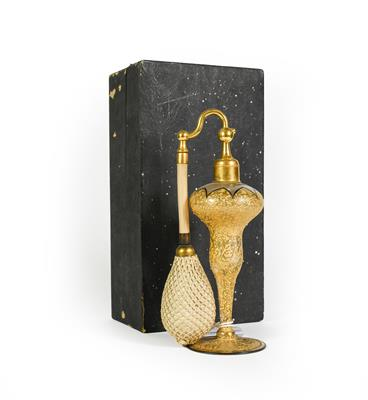 Lot 5 - A Gilt-Metal Mounted Gilt Glass Atomiser bottle, baluster and on spreading foot, in cardboard...