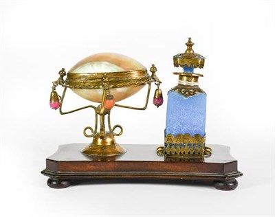 Lot 9 - A Gilt-Metal Mounted Blue-Glass Scent-Bottle, mounted on a wood base with a gilt-metal mounted...