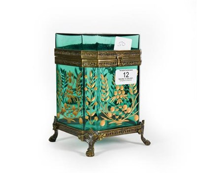 Lot 12 - A Gilt-Metal Mounted Green Glass Casket, of octagonal section and on four paw feet, the glass...