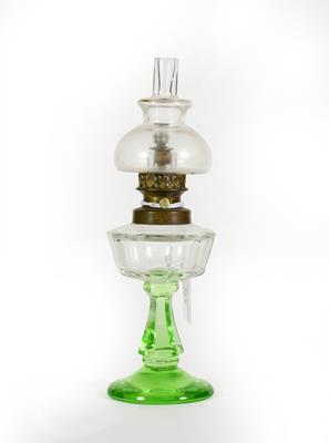 Lot 15 - A Gilt-Metal Mounted Clear and Green Glass Scent-Bottle, in the form of an oil lamp, 18cm high