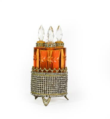 Lot 17 - A set of Four Amber Glass Scent-Bottles, each fitting into the circular paste set stand, total...