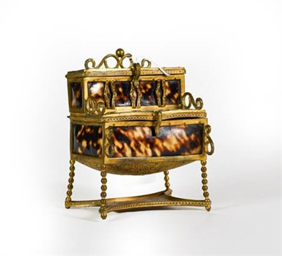 Lot 19 - A Brass-Mounted Faux Tortoiseshell Box, in the form of a desk, hinged in two places which open...