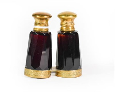 Lot 20 - A Gilt-Metal Mounted Amethyst Glass Double-Scent Bottle, each faceted, the lower mount engraved...