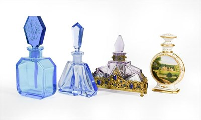 Lot 24 - Three Glass Scent-Bottles, two in blue, the third amethyst glass and with 'gem'-set gilt-metal...