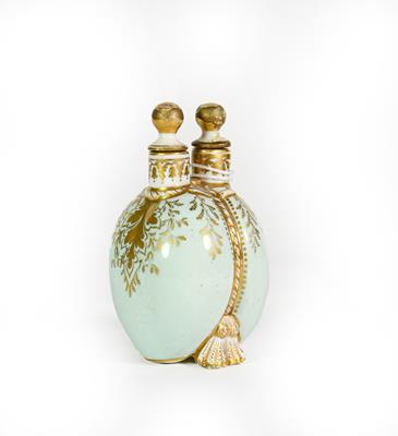 Lot 26 - A Ceramic Double Scent-Bottle, each side bombe and on shell feet, the sides gilt heightened on...