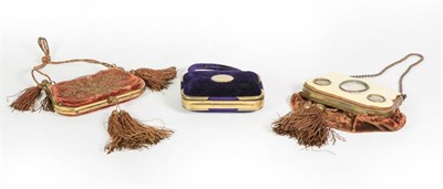 Lot 32 - Three Brass-Mounted Velvet Purses, two cartouche shaped and with tassels, one stitched with foliage
