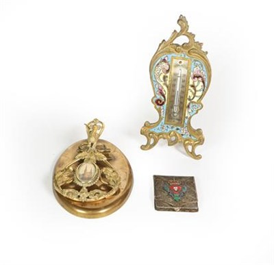Lot 78 - A French Brass and Enamel Thermometer, with easel-back, 17cm high; A brass paperweight, the...