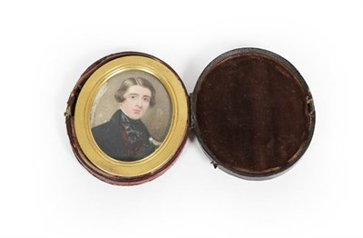 Lot 83 - Continental School, an oval portrait miniature on ivory of a young gentleman in black coat, in...