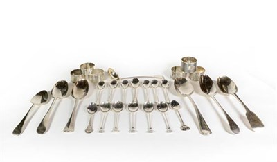 Lot 88 - A group of silver spoons and napkin rings, a serving spoon, George III, Newcastle, another...