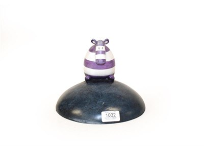 Lot 1032 - P.S (Contemporary) Striped cow on a hill Signed and numbered 17/495, cold cast ceramic, 20cm high