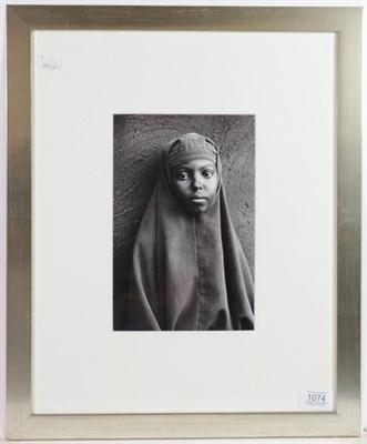Lot 1074 - Sebastião Salgado (b.1944) Brazilian  Portrait of a young girl from the Somalia series...