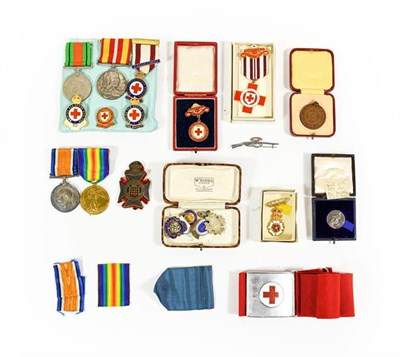 Lot 14 - A First/Second World War Group of Family Medals and Badges, comprising a British War Medal and...