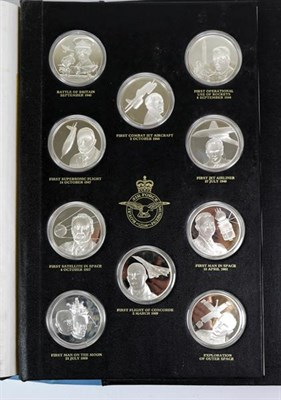 Lot 18 - THE HISTORY OF MAN IN FLIGHT, a set of fifty silver medallions each depicting a famous event within