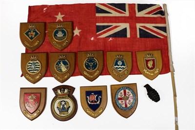 Lot 26 - Militaria, comprising a cast iron copy of a hand grenade, eleven walnut shield shape plaques...