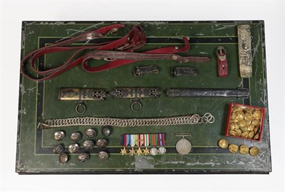 Lot 32 - A Green and Black Japanned Tin Box of Militaria, including a Second World War group of six...