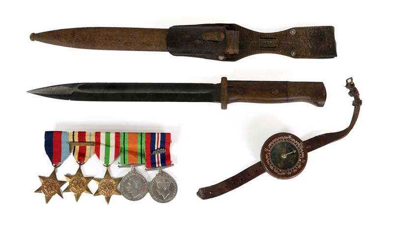 Lot 43 - A US Army Paratrooper's Wrist Compass by Taylor, liquid filled, with bakelite case and leather...