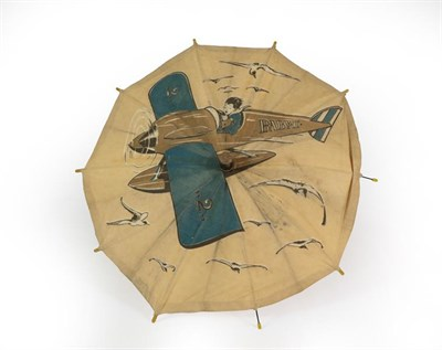 Lot 45 - A Second World War Child's Advertising Umbrella, the white cotton canopy printed with a boy...