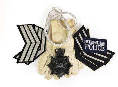 Lot 51 - A Collection of Queen Elizabeth II Metropolitan Police Items, including collar badges, rank...