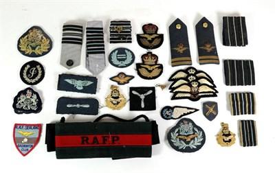 Lot 53 - A Quantity of Post-Second World War RAF Insignia, including mohair cap bands, raised bullion thread