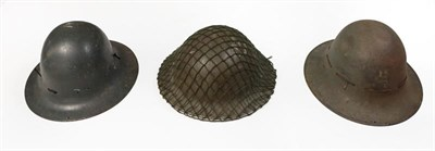 Lot 76 - A Second World War British Brodie Helmet, with original green finish, camouflage netting, liner...