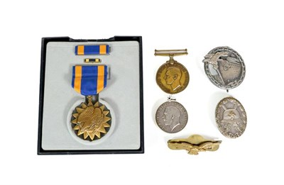 Lot 82 - A German Third Reich Blockade Runner Badge, in white metal, the reverse with magnetic vertical...