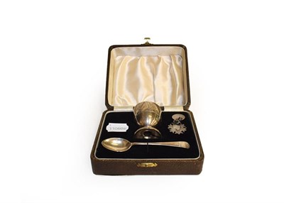 Lot 5 - A selection of silver including an Irish christening mug, cased egg cup and spoon, toast rack,...