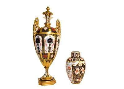 Lot 21 - A Royal Crown Derby twin handled vase in Imari pattern (a.f.) and a small vase and cover (2)