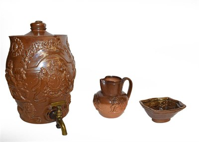 Lot 25 - A quantity of brown and salt glazed stoneware including a spirit barrel sprigged with the Royal...