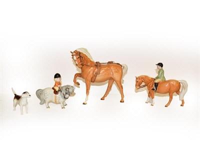 Lot 32 - Beswick Boy on Pony, model No. 1500, palomino gloss, together with Horse (Head Tucked, Leg Up),...
