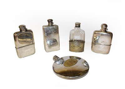 Lot 44 - Five silver plated spirit flasks, one incorporating a cigarette case (one tray)